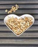 E Υγιή τροφίμων καρύδια των δυτικών ανακαρδίων εικόνας στενά επάνω Σύσταση αγάπης στοκ φωτογραφία με δικαίωμα ελεύθερης χρήσης
