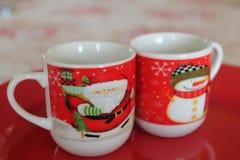 E Φλυτζάνια Χριστουγέννων στοκ φωτογραφίες με δικαίωμα ελεύθερης χρήσης