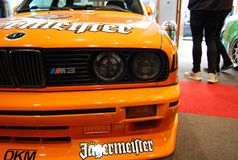 E30. Bmw jagermeister orange front lights low car Stock Photography