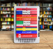E-boock audio learning languages 3d render image on wood flor Stock Images
