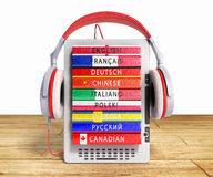 E-boock audio learning languages 3d render on wooden flor. Image Royalty Free Stock Images