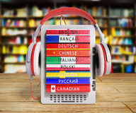 E-boock audio learning languages 3d render on wooden flor in lib. Rary image royalty free illustration