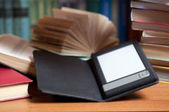 E-Book. And old books. New technologies in book publishing Stock Photos
