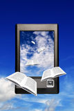 E-book. Books flying into a device for reading digital book, electronic book concept Royalty Free Stock Photos