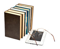 E-book with glasses and paper books Royalty Free Stock Images