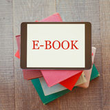 E-book library concept with digital tablet and books Royalty Free Stock Images