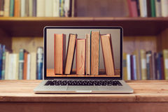 E-book library concept with laptop computer and books Royalty Free Stock Image