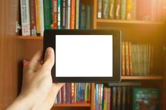 E-book in man`s hand royalty free stock photography