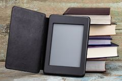E-book and old books. New technologies in book publishing.  Royalty Free Stock Image