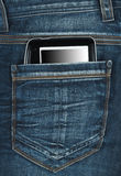 E-book in the pocket. E-book in the back pocket of blue jeans Royalty Free Stock Images