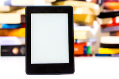 E-Book reader. On background of old books Royalty Free Stock Image