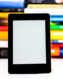E-Book reader. On background of old books Royalty Free Stock Photo