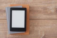 E-book reader on  books Royalty Free Stock Photos