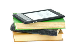 E-book reader and classic paper books Stock Photography