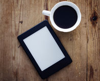 E-book reader and coffee Royalty Free Stock Photo