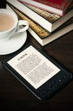 E-book reader device on desk in library Royalty Free Stock Photo