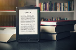 Free E-book Reader Device On Desk In Library Stock Photo - 92796680