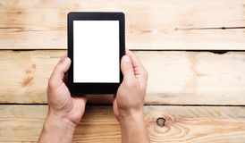 E-book reader or tablet pc in hand Stock Image