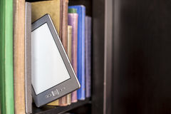 E-book stands on a wooden bookshelf Royalty Free Stock Photo