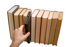 E-book vs old books Stock Photography