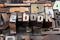 E-book written with letterpress printing blocks. Ebook written with antique letterpress printing blocks on random type background Royalty Free Stock Image
