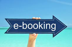 E-Booking pointer. In the hand Stock Photo