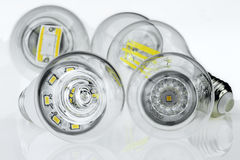 E27 bulbs with different LED chips and light scattering Stock Photo