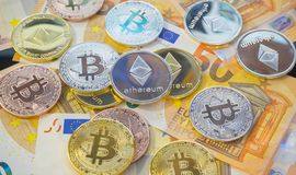 E-business Bitcoin BTC coins on bills of euro banknotes. Worldwi Stock Photography