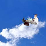 E-business.Businessman on a clouds Royalty Free Stock Photography