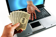 E-business with money. Two hands doing trade through a computer screen Stock Photos