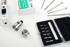 E-cig, keyboard, computer mouse, battery and coffe Royalty Free Stock Photos