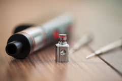 E-cig vaporizer with kanthal clapton coil drip stock photos