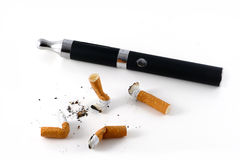 E-cigarette and cigarette butts. Isolated on white background, vaping against smoking Stock Photo
