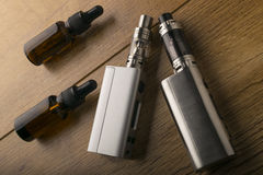E cigarette or electronic cigarette for vaping mods. Stock Photos