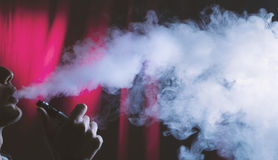 E cigarette or electronic cigarette vaping and smoking. Stock Image