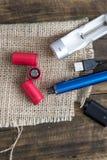 E-cigarette equipmen on table Royalty Free Stock Images