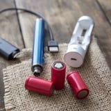 E-cigarette equipmen on table Stock Photo