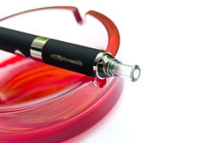 E-cigarette on red ashtray Stock Photo