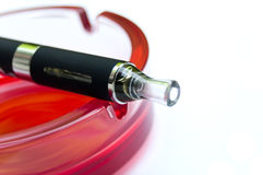 E-cigarette on red ashtray Royalty Free Stock Photography