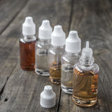E-cigarettes,  different re-fill bottles Royalty Free Stock Photo