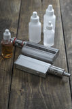 E-cigarettes with lots of different re-fill bottles Stock Photography
