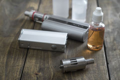 E-cigarettes with lots of different re-fill bottles Royalty Free Stock Images