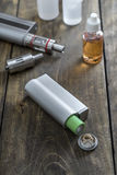 E-cigarettes with lots of different re-fill bottles Stock Images