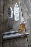 E-cigarettes with lots of different re-fill bottles Stock Photos