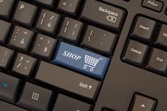 E-commerce key on keyboard. E-commerce blue key on keyboard royalty free stock photography
