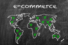 E-commerce business. Written on a blackboard with world map sign Royalty Free Stock Photo