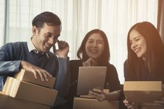 E commerce business team smiling while checking order. Success concept Royalty Free Stock Photos
