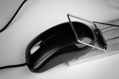 E commerce. Computer mouse in a trap, a  e commerce and computer addiction concept Stock Photo