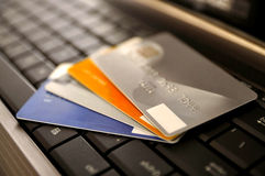 E-Commerce Concept. Group of credit cards and laptop with shallow DOF Royalty Free Stock Images