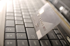 E-Commerce Concept. Credit card and laptop with shallow DOF royalty free stock photos